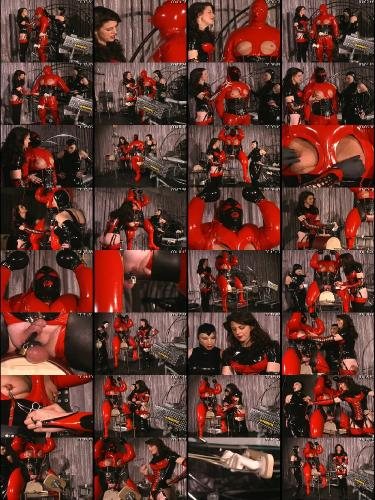 fat-man-in-latex-sits-on-the-sybian-MED